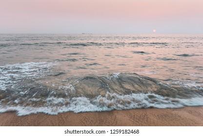 Kannur, Kerala, India. Sunset across the Arabian Sea on a fine winter evening as viewed from Thottada beach, Kannur, Kerala, India.