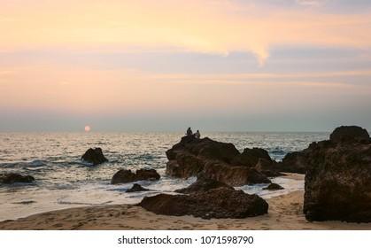 Kannur, Kerala, India. Thottada sandy beach bathed in the light of the setting sun overlooking the Arabian sea near Kannur, Kerala, India.