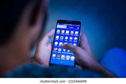 Kannur/Kerala/India - October, 19, 2018: Closeup Shot of young men using smart phone, mobile addiction concept