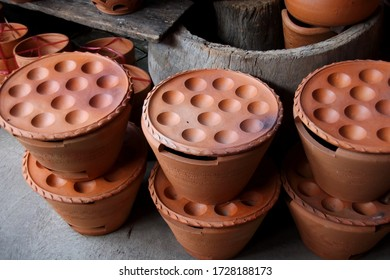 """Kanom Krok pan set  made from clay are selling in shop, Thailand. Kamon Krok pan in retro style shape used for make Thai dessert  name is """"Kanom Krok"""".  - Shutterstock ID 1728188173"""