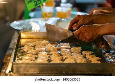 Kanom Krok, a popular Thai dessert street food on Phuket Island in Thailand, Asia
