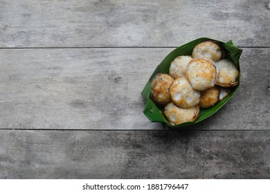 Kanom Krok or Thai coconut pudding contained in banana leaf package on wooden table. Kind of Thai sweetmeat. Mortar-toasted pastry. It made of coconut milk - Shutterstock ID 1881796447
