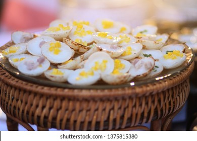 Kanom Krok is Thai Sweet dessert and savory grilled coconut-rice hotcakes in basket.