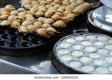 """""""Kanom Krok""""  is a traditional Thai dessert. Coconut-rice pancakes.  Sweet and Savory Grilled Coconut-Rice Hotcakes."""