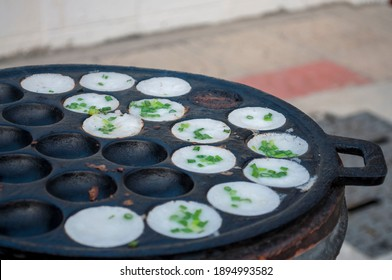 Kanom Krok, a traditional Thai dessert made from crushed coconut meat.  - Shutterstock ID 1894993582