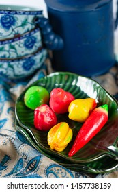 Kanom Luk Chup (Look Choup) is a Thai sweet dessert made of mung bean paste, shaped and colored like mini fruits and glazed with clear agar-agar
