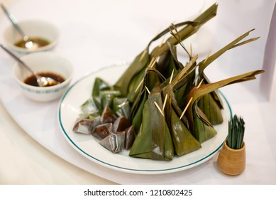 Kanom thai - Thai sweet made from coconut milk wrapped with banan leaf
