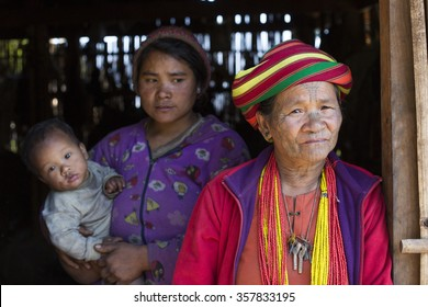 KANPETLET MYANMAR, DECEMBER 9: Chin tribe tattoed woman (Muun) poses for a photo on December 9, 2015 Kanpetlet, Myanmar. Also known as the Kakis they are a number of Tibeto-Burman tribal people.