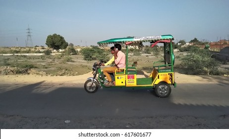 KANPUR, UTTAR PRADESH, INDIA - 26 MARCH, 2017: An unidentified poor Indian urban man driving E rickshaw at street.