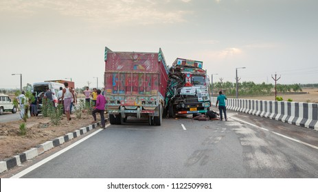Kanpur, Uttar Pradesh / India - June 02 2018: Accident of two loaded transport trucks on highway.