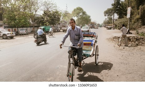 Kanpur, Uttar Pradesh / India - Mar 23 2012: An Indian Rickshaw puller in the rural area of India.