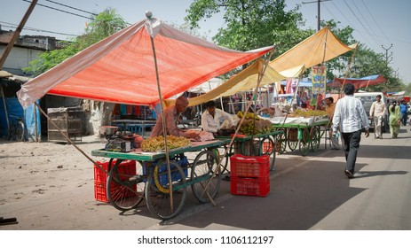 Kanpur, Uttar Pradesh / India - Mar 23 2012: Concept of rural business. Street Fruit Market in the rural area of India.