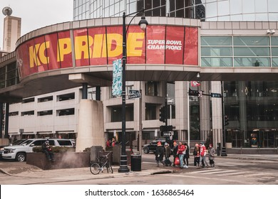 Kansas City, Missouri - February 5, 2020: Kansas City Chiefs football fans walking under a KC Pride banner after the Chiefs Kingdom Parade in downtown Kansas City.