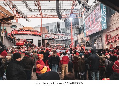 Kansas City, Missouri - February 5, 2020: Kansas City Chief fans celebrating at Power and Light District during the Chiefs Kingdom Parade in downtown Kansas City