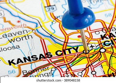 Kansas City Missouri highlighted with blue push pin on atlas or map closeup