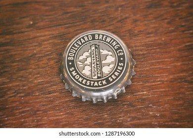 KANSAS CITY, MISSOURI - JAN 14, 2019: Boulevard Brewing Company beer bottle cap on wood table. American craft beer maker based in Kansas City, Missouri.
