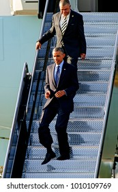 Kansas City Missouri, USA, 29th July, 2014 President Barak Obama walks down the steps from AIr Force One after arriving at MCI Airport this evening. The President is in Kansas CIty to deliver a speech