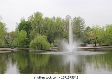 Kansas City, Missouri / USA - April 24 2019: Fountain in Lake, Loose Park, Kansas City, Missouri in Spring Time
