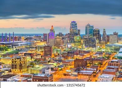 Kansas City, Missouri, USA downtown cityscape at twilight from above.