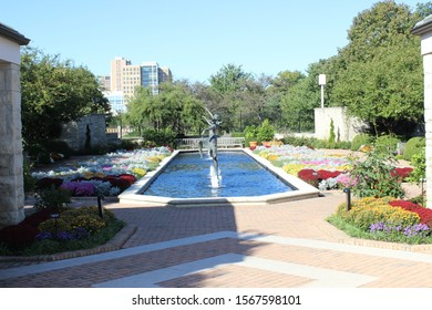 Kansas City, Missouri / USA - October 7 20198: Fountain Surrounded by Colorful Fall Plantings at Ewing & Muriel Kauffman Memorial Garden