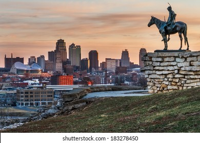 Kansas City, Missouri, USA on March 22, 2014.  A image of the Kansas City Scout overlooking Kansas City at sunrise.  The Indian Scout is known as a Kansas City landmark and symbol of the city.