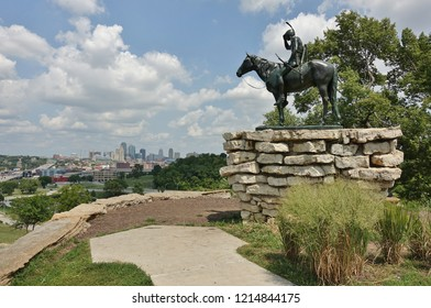 KANSAS CITY, MO -17 AUG 2018- View of the famous Scout sculpture of a Sioux Indian on horseback surveying the landscape downtown skyline of Kansas City, Missouri.