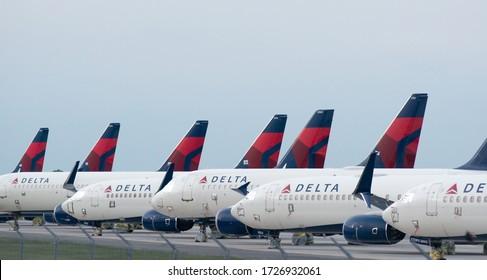 Kansas City, MO - May 9, 2020: Delta Airplanes sit in a row at Kansas City International Airport