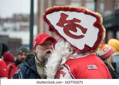 Kansas City, MO / United States of America- February 5th, 2020: A Chiefs fan with a custom Santa suit interacts with other fans at the championship rally in front of Union Station after Super Bowl win