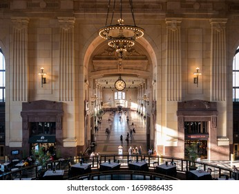 Kansas City, MO / United States of America - February 18th, 2020: View of the interior of Union Station in downtown KC from upper mezzanine, looking down main hallway, with chandeliers and warm light.