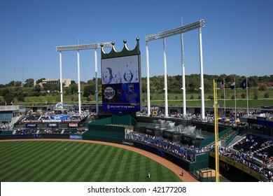 KANSAS CITY - SEPTEMBER 27: Royals fans watch in a baseball game near the signature crown scoreboard and fountains of Kauffman Stadium on September 27, 2009 in Kansas City, Missouri.