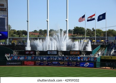 KANSAS CITY - SEPTEMBER 27: Royals fans take in a baseball game in front of famous KC fountains at Kauffman Stadium on September 27, 2009 in Kansas City, Missouri.