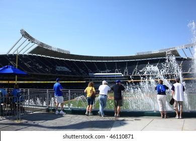 KANSAS CITY - SEPTEMBER 27: Royals fans watch a late season baseball game through famous KC fountains at Kauffman Stadium on September 27, 2009 in Kansas City, Missouri.