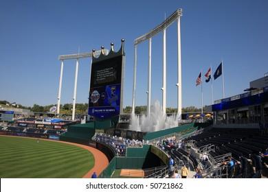 KANSAS CITY - SEPTEMBER 27: Royals fans watch a baseball game near the signature crown scoreboard and fountains of Kauffman Stadium on September 27, 2009 in Kansas City, Missouri.