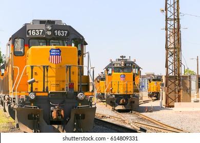 KANSAS CITY, USA - MAY 21, 2016: Switching of engines and trains at a railroad yard in Kansas City.