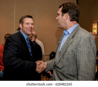 Kansas Secretary of State Kris Kobach (L) shakes hands with Kansas Attorney General Derek Schmidt at the Ron Estes election night victory party Wichita Kansas, April 11, 2017. Photo by Mark Reinstein