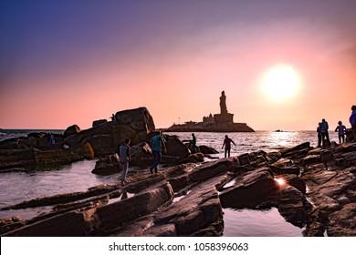 Kanyakumari, Tamil Nadu, India - February 12, 2017 : Unidentified tourists take a sunset view of Swami Vivekananda Memorial rock and thiruvalluvar island in Kanyakumari, India
