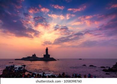 Kanyakumari, Tamil Nadu, India - February 11, 2017 : Unidentified tourists take a sunset view of Swami Vivekananda Memorial rock and thiruvalluvar island in Kanyakumari, India