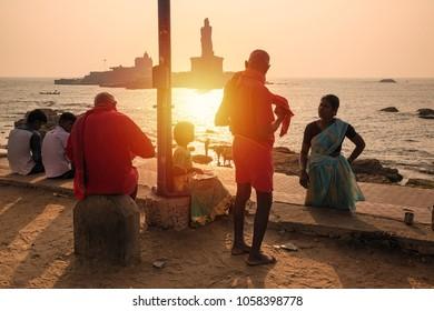 Kanyakumari, Tamil Nadu, India - February 11, 2017 : Unidentified tourists busy in morning activities in front of Swami Vivekananda Memorial rock and thiruvalluvar island in Kanyakumari, India