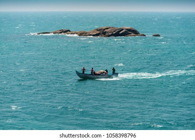 Kanyakumari, Tamil Nadu, India - February 11, 2017 : single transport fisherman boat / ship in the blue water under blue sky as background, kanyakumari, tamil nadu, India