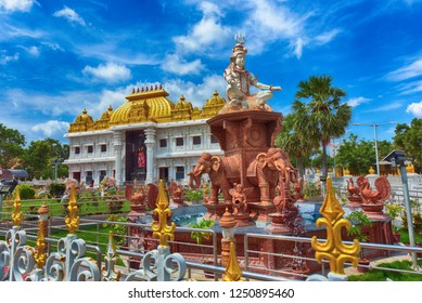 KANYAKUMARI, TAMIL NADU, INDIA, NOVEMBER 02, 2018: HDR image of Ramayana Darshanam exhibition hall and statue of Lord Shiva in the garden at Vivekananda Kendra.