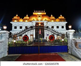 KANYAKUMARI, TAMIL NADU, INDIA, NOVEMBER 02, 2018: The palatial, illuminated Ramayana Darshanam exhibition hall at night, view from outside the gate at the Vivekananda Kendra.