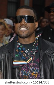 Kanye West, wearing a Louis Vuitton scarf, at MISSION IMPOSSIBLE III Premiere, Magic Johnson Theaters in Harlem, New York, NY, May 03, 2006