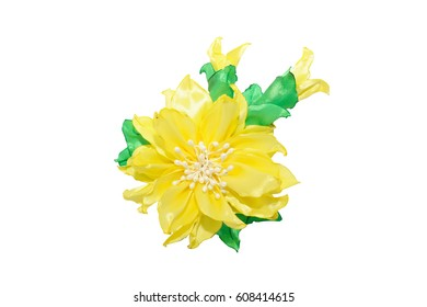 Kanzashi. Yellow artificial flower isolated on white background