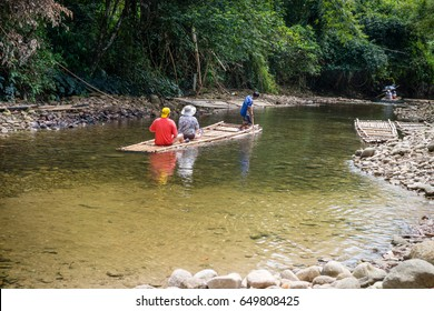 KAO LAK, THAILAND - 24 FEB 2017: Bamboo rafting in green tropical scenery as a tour for tourist in Thailand