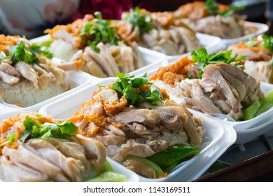kao mun kai is oily rice and Chicken  the dish's popularity in thailand (hainanese chicken rice)