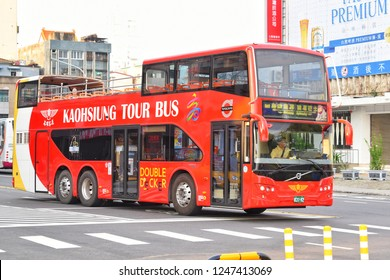 Kaohsiung City, TAIWAN - 20 July 2018 :  Two-floor bus tour in Kaohsiung, some upstairs, no roof to beautiful scenery.