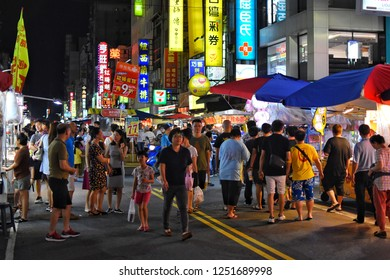 Kaohsiung City, TAIWAN - 22 july 2018 : Many Taiwanese and tourists are walking on the Liuhe Tourist Night Market, One of the most famous night markets in Taiwan.