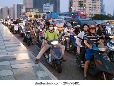 KAOHSIUNG CITY, TAIWAN - 5 OCTOBER 2014: Traffic on the bridge through Love River. People are riding scooters - the most popular transport in Taiwan. Kaohsiung city, Taiwan