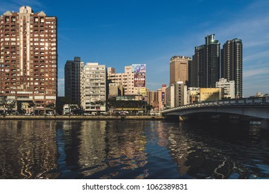 Kaohsiung, Taiwan, 04.29.2017 - View of Love River, bridge and the city in the evening light, editorial image