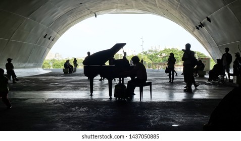 KAOHSIUNG, TAIWAN -- APRIL 14, 2019: A piano performance in the ipublic areas of the recently completed National Center for the Performing Arts located in the Weiwuying Metropolitan Park